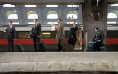 Group of business people waiting for a train on a platform