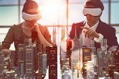two business persons are developing a project using virtual reality goggles. the concept of technolo poster