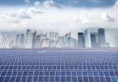 Photovoltaic installations with cityscape on the background
