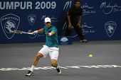 KUALA LUMPUR, MALAYSIA - OCTOBER 2: Czech Republicâ's Tomas Berdych anticipating to return a shot in the Malaysian Open Tennis ATP tour. October 2, 2009 in Kuala Lumpur Malaysia.