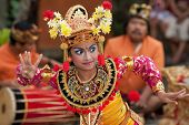BALI - JANUARY 15: Young Balinese girl performs a welcome dance in a 'full moon ceremony' in the Bed
