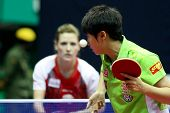 KUALA LUMPUR, MALAYSIA - SEPTEMBER 24: Guo Yue of China serves against Natalia Partyka of Poland at