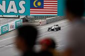 KUALA LUMPUR - APRIL 2: BMW Sauber's Pedro de la Rossa drives by under the watchful eyes of the spec