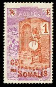 vintage stamp from Somalia depicting tribal goat herder with drum in hand