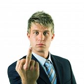 A businessman in a suit giving the finger