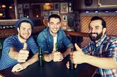 Постер, плакат: people leisure friendship gesture and bachelor party concept happy male friends drinking bottle