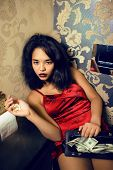 pretty young african american woman in luxury restroom with money, like prostitute poster