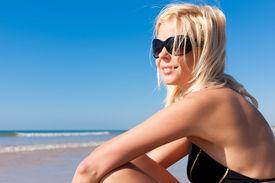 pic of monokini  - Attractive Woman in monokini standing in the sun on beach - JPG