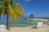 Lovers Seat On The Beach In Jamaica poster
