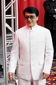 LOS ANGELES - JAN 11: Jackie Chan in white jacket poses at the Jackie Chan wax figure unveiling at Madame Tussauds Hollywood in Los Angeles, California on January 11, 2010