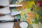 fine art, creativity and artistic tools concept - close up of palette knives or painting spatulas an poster