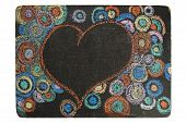Heart and circles on black chalkboard
