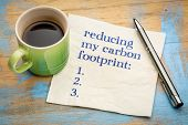 reducing my carbon footprint list - handwriting on a napkin with a cup of espresso coffee poster