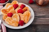 Heart Shaped Pancakes With Raspberries And Honey For St. Valentines Day poster