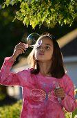 Girl Blows a Bubble