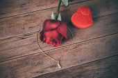 Red Rose Flower On Wooden Floor In Valentines Day poster