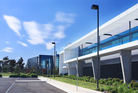 picture of modern building  - Modern industrial building on sunny day with blue sky behind - JPG