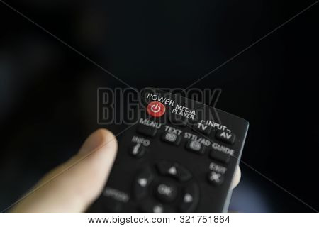 poster of Close Up On A Mans Hand With The Remote Control Want Switch On The Tv And Presses The Button On The