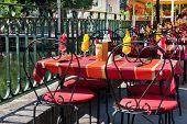Colorful French bistro terrace near the water in Isle de La Sorgue