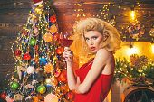 Beautiful Blonde Girl Over Christmas Tree. Retro Pin-up Woman Posing On Vintage Wooden Christmas Bac poster