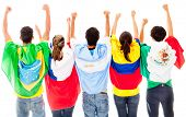 Happy Latinamerican group with arms up ad flags - isolated over a white background