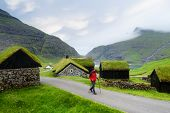 Saksun Village, Streymoy Island, Faroe islands. Old stone houses with a grass (turf) roof. Tourist s poster