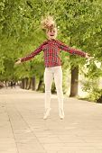 Fresh Air Gives Her The Vital Energy. High Energy Or Hyperactive Kid. Small Girl Jumping In Casual F poster