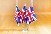 Three Flags On The Table. Flags Of United Kingdom. Flags Of United Kingdom On The Table During A Mee poster
