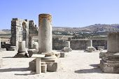 Ruins and columns of the Basilica in Volubilis, Roman city near to Meknes, the ancient capital of Ma poster