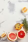 Lemon, lime, orange and pink grapefruit slices on white plaster texture background with copy space f poster