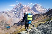 Hiking In Fann Mountains, Pamir, Alay, Tajikistan. Trekking In High Mountains. Tourist With Backpack poster