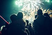 Crowd Watching Fireworks And Celebrating New Year Eve poster