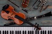musical instruments in wooden background poster
