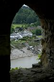 foto of chepstow  - View through stone window of houses by river - JPG