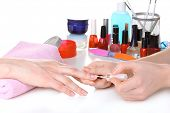 stock photo of nail paint  - Manicure process in beautiful salon - JPG