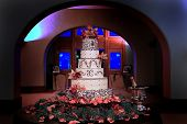 Six Tiered Wedding Cake With Pink Orchids