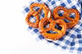 Traditional Bavarian Salty Pretzels On Blue Table Cloth, Close Up Isolated poster