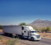 stock photo of semi-truck  - Large truck speeding through the South West desert of Arizona - JPG