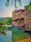 Vieu At The Mill Of Millau, On The Tarn River, In Southern France/ Bridge Pont Vieux And Watermill O poster