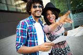 Happy Black Couple On Vacation Sightseeing City With Map poster