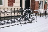 Bike Covered With Fresh Snow. poster