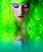 green fairy girl head down with reflection in water