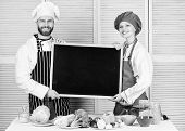 Hands On Cooking Class. Couple Of Man And Woman Holding Empty Blackboard In Cooking School. Chef And poster