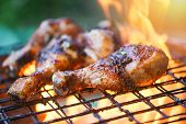 Grilled Chicken Legs Barbecue With Herbs And Spices / Tasty Chicken Legs On The Grill With Fire Flam poster