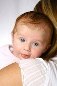 Baby Girl On Her Moms Shoulder