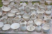 A pottery collection of bowls, vases and other assorted greenware