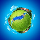 Mini planet concept. Three houses on the different poles with small river / rivulet and wooden bridges. Earth collection.