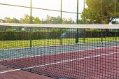 Sports Ground, Tennis Court At The Hotel. A Net Stretched On A Tennis Court, A Sports Ground Of A Tu poster