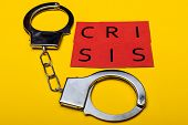 Illegal Drug Crisis Concept Showing Handcuffs And The Message Crisis On A Yellow Background poster