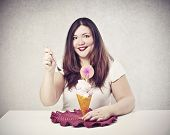 happy fat woman with sundae